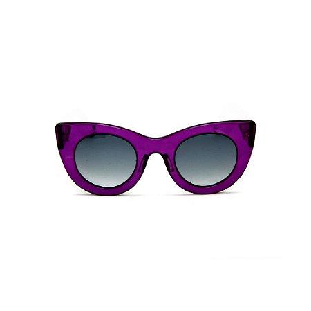 Óculos de Sol Gustavo Eyewear G48 10. Cor: Violeta translúcido. Haste animal print.