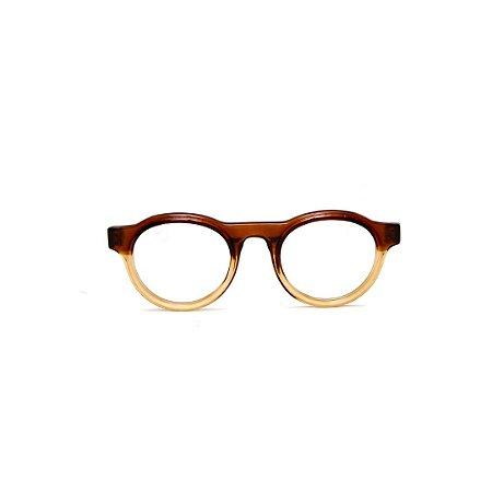 Armação para óculos de Grau Gustavo Eyewear G77 6. Cor: Marrom translúcido e âmbar. Haste marrom.