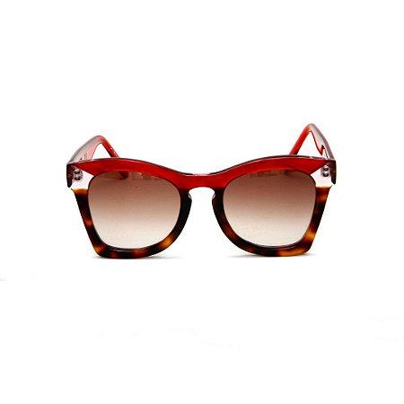Óculos de sol Gustavo Eyewear G75 8. Cor: Vermelho translúcido, animal print e fumê. Haste vermelha. Lentes marrom.