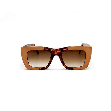 Óculos de sol Gustavo Eyewear G79 10. Cor: Animal print com nude. Haste animal print. Lentes marrom.