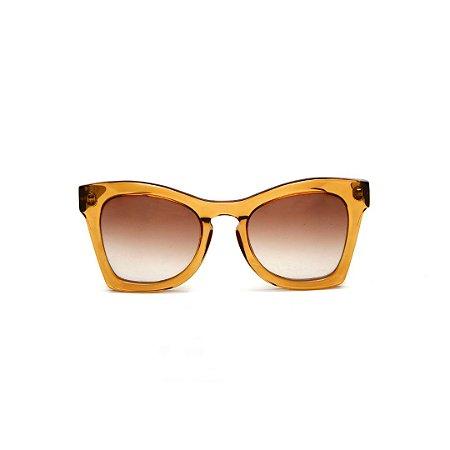 Óculos de sol Gustavo Eyewear G75 10. Cor: Âmbar. Haste marrom. Lentes marrom.