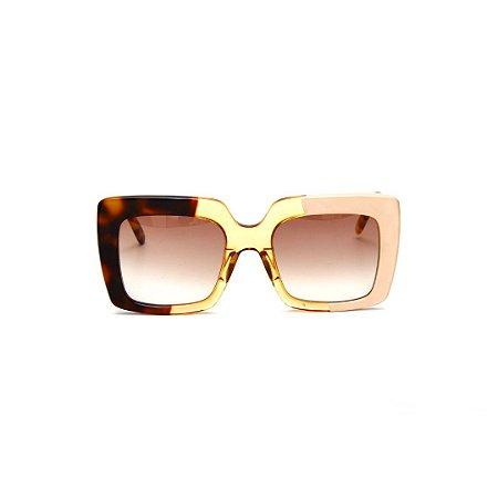 Óculos de sol Gustavo Eyewear G59 5. Cor: Animal print, âmbar e nude. Haste animal print. Lentes marrom.