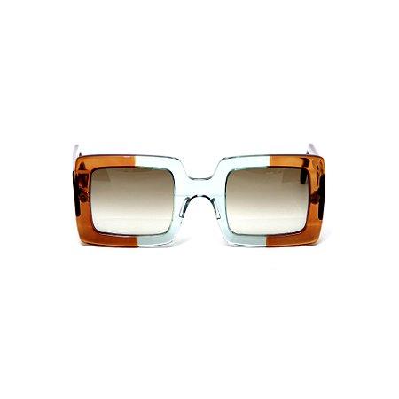 Óculos de sol Gustavo Eyewear G01 3. Cor: Caramelo e acqua translúcido. Haste caramelo. Lentes marrom.