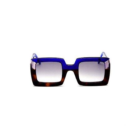 Armação para óculos de Grau Gustavo Eyewear G1 8. Cor: Animal print, azul e fumê. Haste azul. Lentes cinza.
