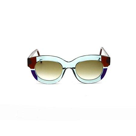Óculos de sol Gustavo Eyewear G12 3. Cor: Acqua, azul e marrom. Haste marrom. Lentes marrom.