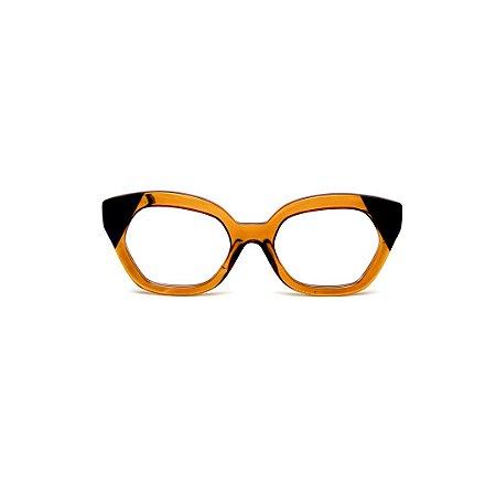 Armação para óculos de Grau Gustavo Eyewear G70 16. Cor: Âmbar e preto. Haste azul.