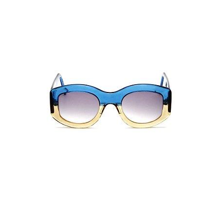 Óculos de sol Gustavo Eyewear G60 6. Cor: Azul translúcido e âmbar. Haste azul. Lentes marrom.
