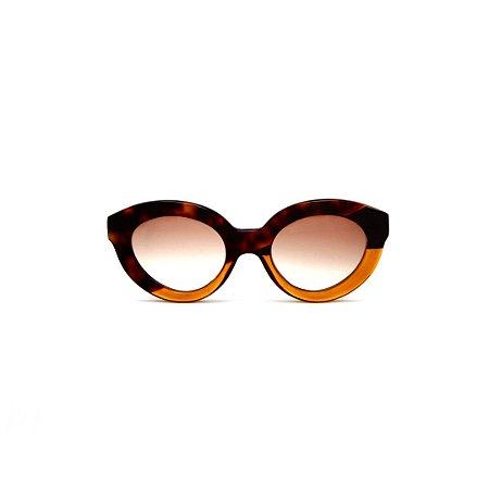 Óculos de sol Gustavo Eyewear G25 14. Cor: Animal print, preto e laranja translúcido. Haste animal print. Lentes marrom.