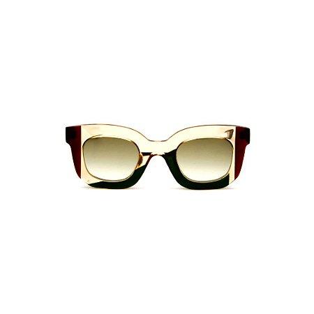 Óculos de Sol Gustavo Eyewear G31 12. Cor: Âmbar, verde e vermelho translúcido. Haste animal print. Lentes marrom.