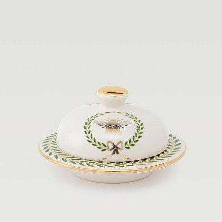 Manteigueira em Cerâmica com fino acabamento em ouro.