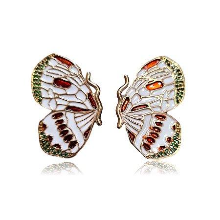 Brinco borboleta branca  e cobre com zircônias esmeralda .