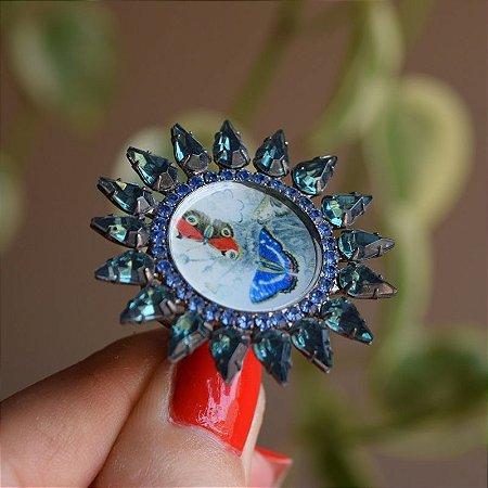 Anel Lázara Design redondo cristais azul e verde