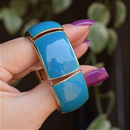 Bracelete metal esmaltado azul com dourado