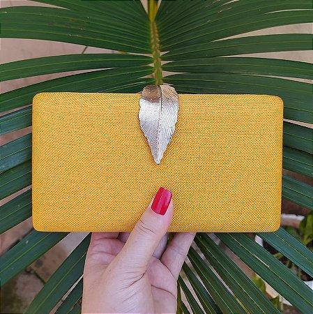 Clutch tecido amarelo fecho folha
