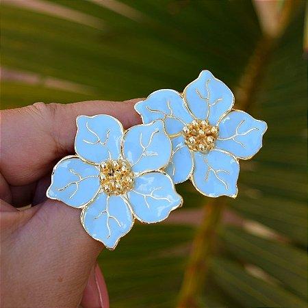 Brinco flor azul claro dourado