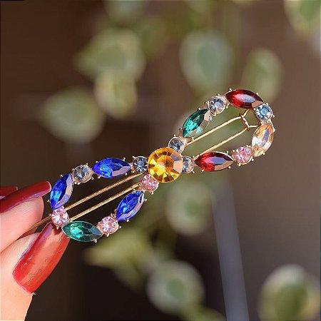 Presilha infinito metal dourado com cristais coloridos
