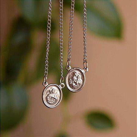 Escapulário aço inoxidável oval Nossa Senhora do Carmo e Sagrado Coração de Jesus