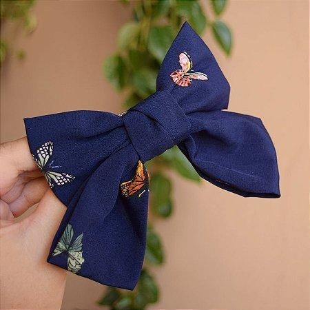 Presilha laço borboletas azul marinho