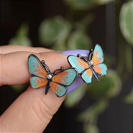 Brinco borboleta pintada à mão verde e laranja