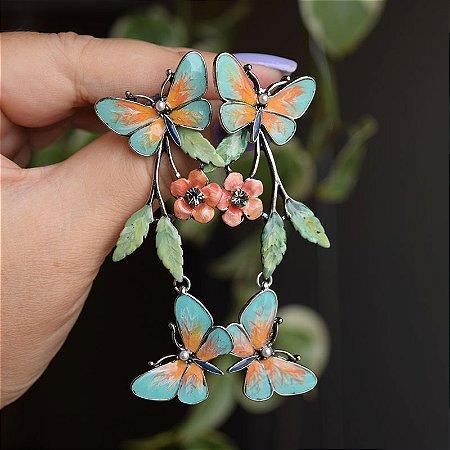 Brinco borboletas pintado à mão laranja e verde