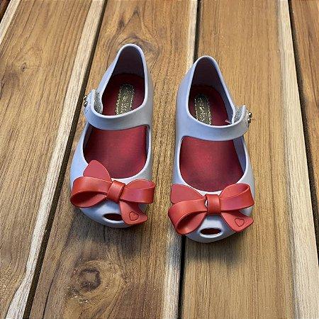 MELISSA sapatinho com lacinho vermelho BRA 19