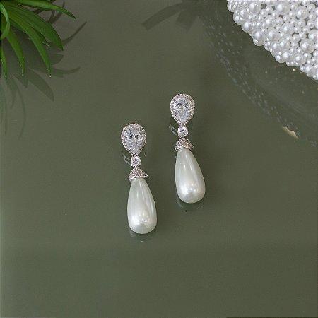Brinco de pérola em ródio branco com cristal transparente e cravação em zircônias