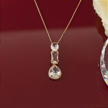Colar dourado com cristal transparente