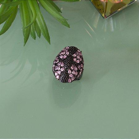 Anel  cravejado com zircônias negras e cristal rosa