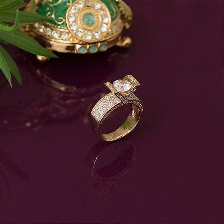 Anel dourado com travação em micro zircônias e cristal transparente
