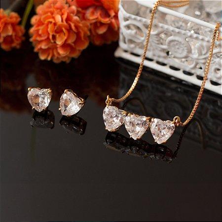 Conjunto dourado com 3 corações cristais