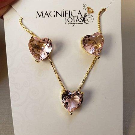 Conjunto dourado de coração com cristal rosa
