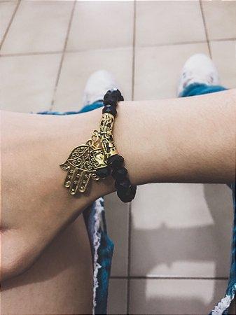 Pulseira VIBE, preta, dourada, mão de fátima - REF P230