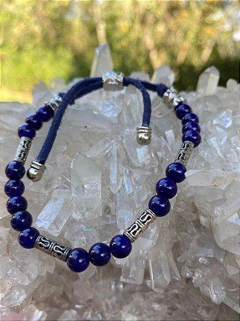 Pulseira com fecho regulável de cordão, esferas de vidro (tipo murano) azul royal,com entremeios de metal banhado.