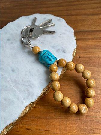 Chaveiro esferas de madeira com peça indiana turquesa.