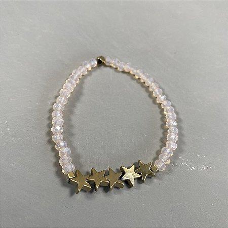Pulseira de cristais tchecos lapidados translúcidos e estrelas em metal banhado.