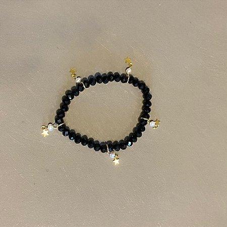 Pulseira de cristais lapidados  preto e pingentes de estrelas e pérolas barrocas.