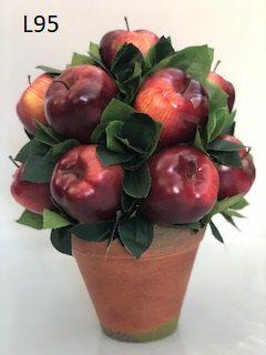 Bool maçã vermelha com folhagem verde no vaso