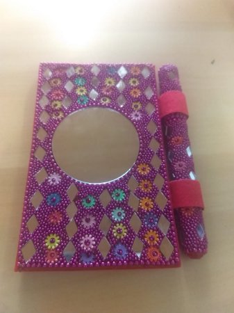 caderneta com espelho e caneta