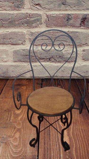Cadeira em ferro madeira com braço