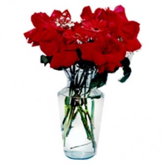 Jarra de vidro de rosas importadas com gerberas