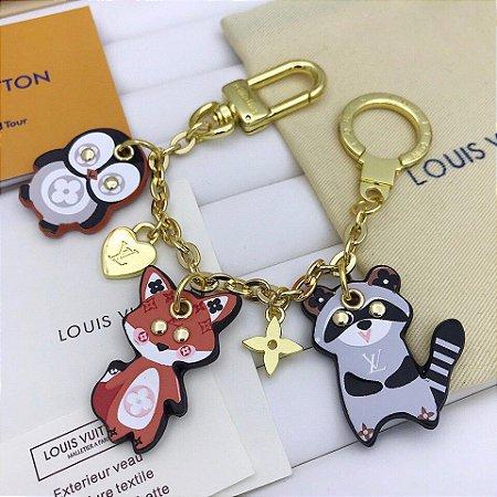 """Chaveiro Louis Vuitton Animal Family """"Gold"""""""