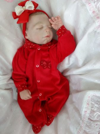 Bebê reborn menina, cabelos pintados, corpo em tecido, 1,7 kg e 45 cm