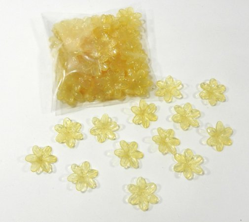 Flores de plástico amarelo - pacote com 50 gr.