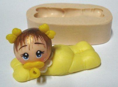 700 - Corpo de bebê m. deitado