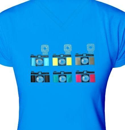 ST028 - Baby Look - Estampa Câmeras Fotográficas em tecido recorte laser e strass