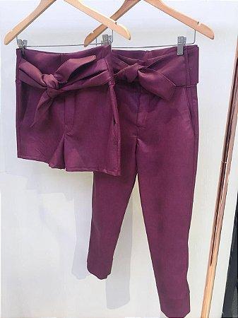Shorts clochard em couro eco cor uva