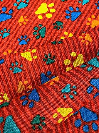 Tecido Gorgurinho patinhas coloridas vermelho