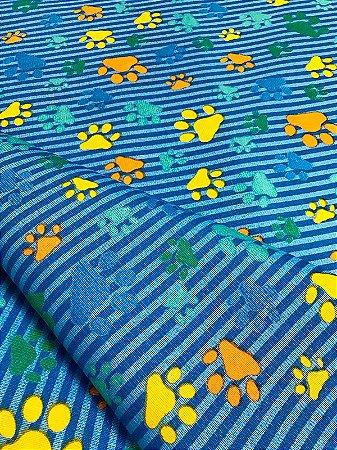 Tecido Gorgurinho patinhas coloridas azul