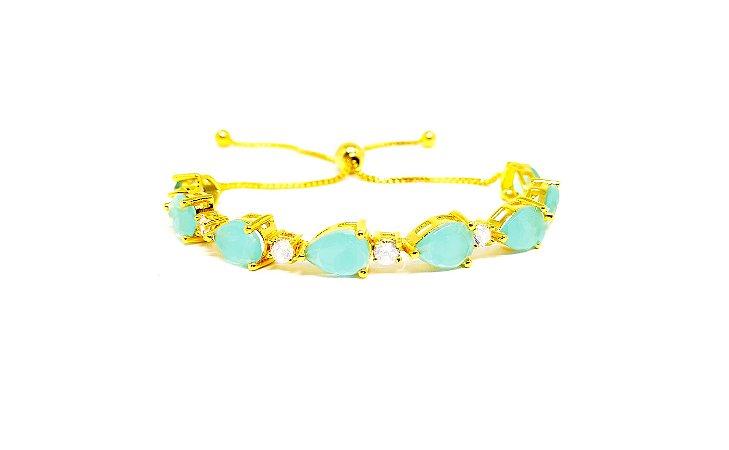 Pulseira folheada a ouro 18k regulável com zirconias na cor azul água marinha