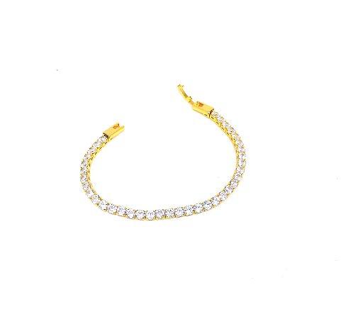 Pulseira folheada em ouro 18k modelo riviera com zirconias na cor cristal.